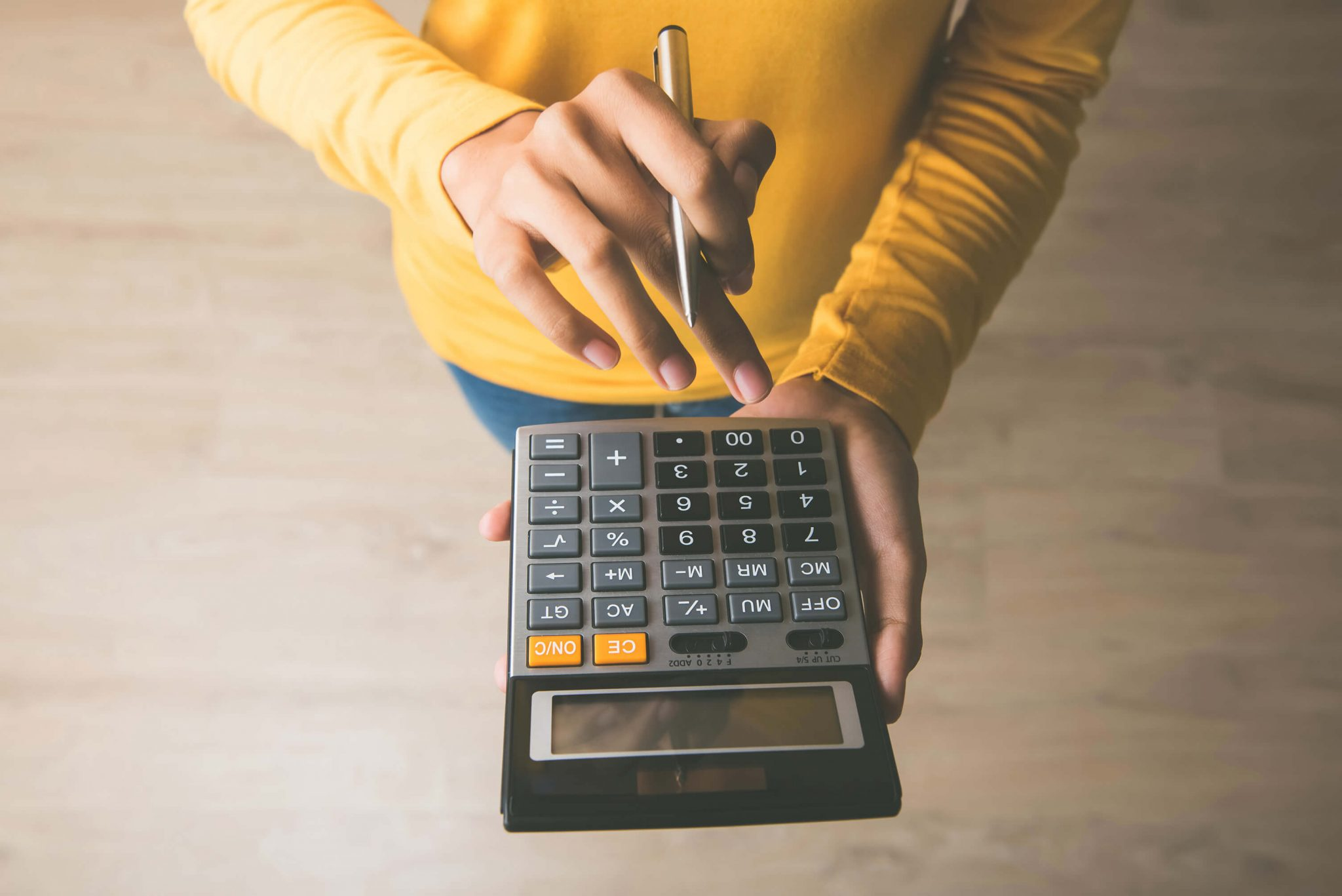 DPS tax accountant using a calculator